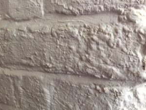 English speaking surveyor in France. Masonry paint trapping moisture
